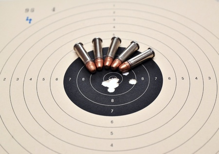 Detail on holes in target and ammunition Stock Photo - 12940518
