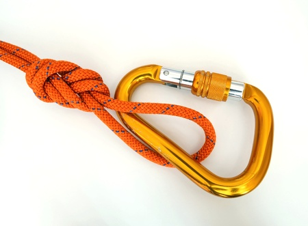 Climbing equipment - detail carabine with a few scratches and knot Stock Photo - 13156278