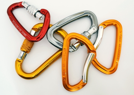 karabiner: Climbing equipment - five multicolor carabiners with a few scratches  Stock Photo