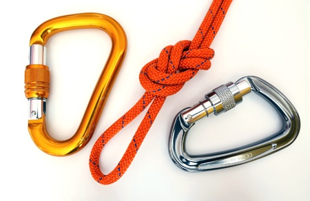 climbing cable: Climbing equipment - carabiners with a few scratches and knot Stock Photo