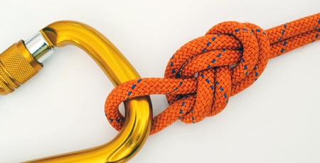 Climbing equipment - detail carabine and knot Stock Photo - 13156281