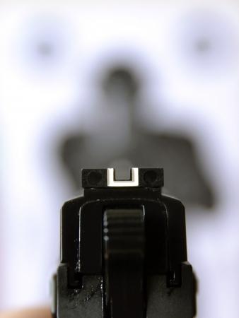 Aiming gun at target Zdjęcie Seryjne