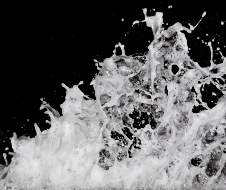 Abstract water splash on black background photo