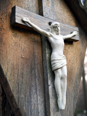 Wooden cross with crucified Jesus Christ at cemetery Stock Photo - 16268475