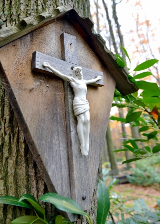 Small wodden cross with Jesus Christ crucifixed Stock Photo - 16268512