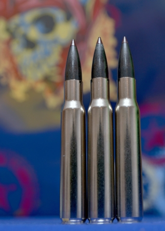 Detail of bullets on background with skull photo