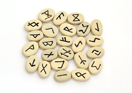 fortune telling of the nordic runes on white background photo