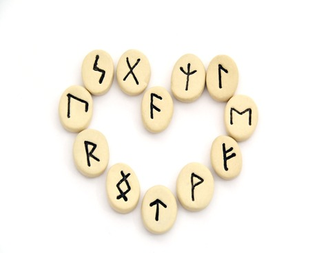 futhark: nordic runes - heart shape on white background