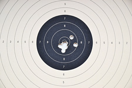Detail on holes in paper target without ammunition