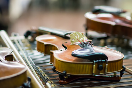 violins: Close up of violins music instrument laying on dulcimer