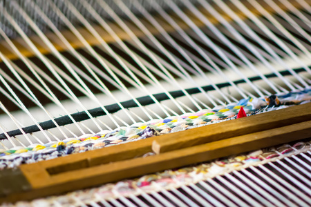 weaving: Detail of traditional weaving loom and thread