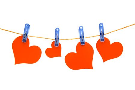 Four red hearts drying on the rope