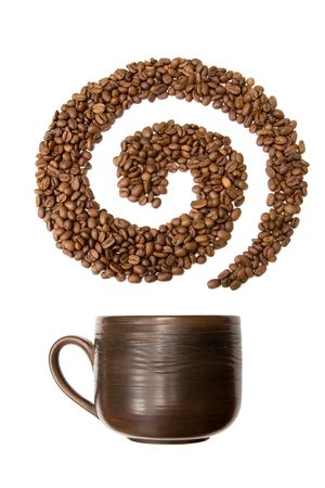 Coffee grains lying in the shape of a swirl with the cup Stock Photo