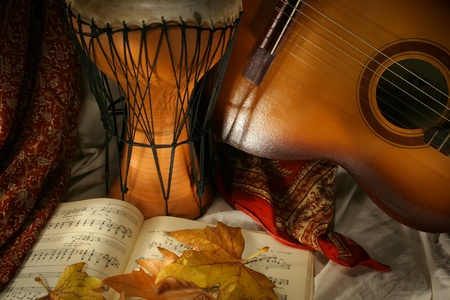 ethno: Drum and guitar with notes and yellow  autumn leaves Stock Photo