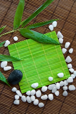 Background with stones and bamboo leaves
