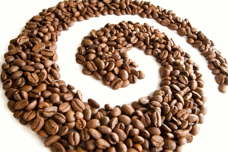 Coffee grains lying in the shape of a swirl  Stock Photo