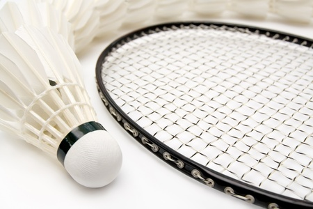 nylon string: Row of shuttlecocks with badminton racket. Close-up