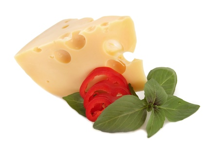 Delicious cheese, red pepper and basil on white background