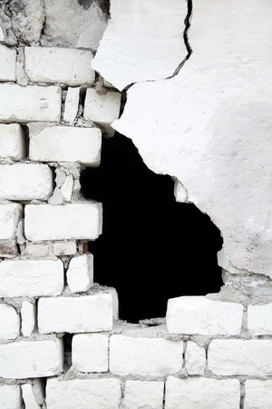 broken house: Texture of old broken brick wall with black hole in it Stock Photo