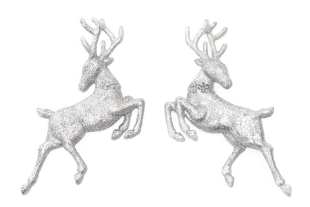 Christmas ornaments - two figures of glittering deer isolated on white photo