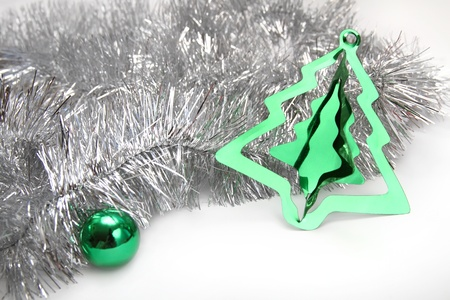 gewgaw: Christmas background with silver tinsel, green sphere and stylish cristmas tree decoration
