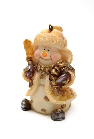 Figurine of a cheerful snowman isolated on white