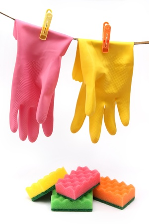 Set of household equipement - protective gloves and colorful cleaning sponges Stock Photo - 9111104