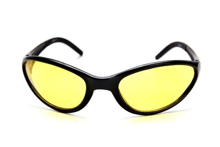 Yellow safety glasses for works, shooting and tourism. Isolated Stock Photo