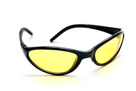 Yellow safety glasses for different works, sooting, cycling and tourism. isolated on white Stock Photo