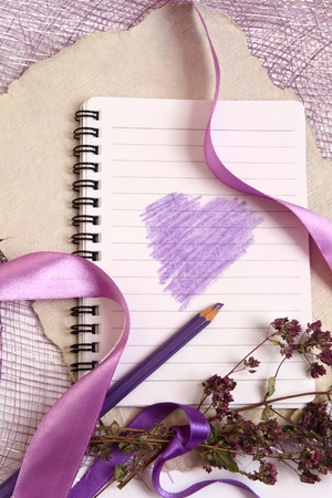 Valentine background with writing-pad, old texturized paper, herbs and beautiful ribbons.    Vertical composition