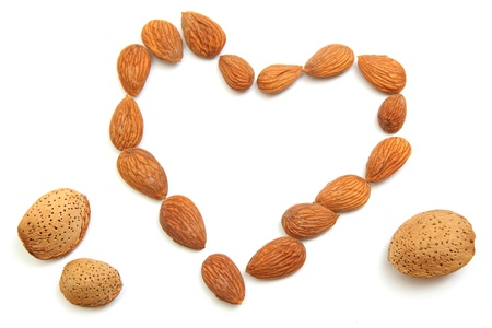 Fresh tasty almond  nuts forming a shape of the heart