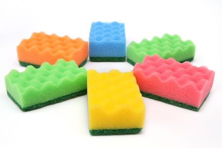 Close-up of  bright-colored  sponges for cleaning and home care - isolated on white background Stock Photo