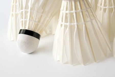 Close-up of white badminton shuttlecocks as a background