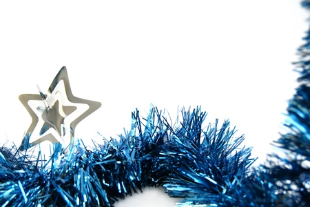Christmas tinsel with silver star isolated