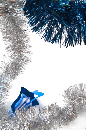 gewgaw: Christmas tinsel - silver and blue - on white background Stock Photo