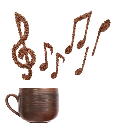 Composition with cup and music notes formed of coffee beans - isolated