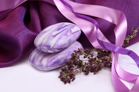Scented soap with herbs and purple decorative fabric