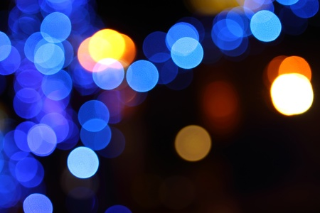 Abstract holiday background of multi-colored lights. Photo