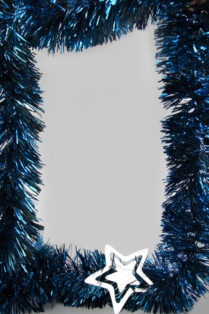 Blue Christmas ornaments frame with silver star and light-gray background