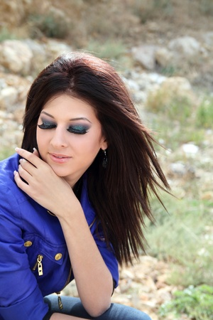 Portrait of beautiful girl with stylish make-up, closed her eyes
