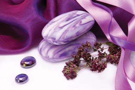 Purple aromatic soap with herbs and  decorative fabric Stock Photo