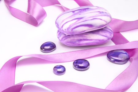 Aromatic soap with rosy ribbons and decorations Stock Photo