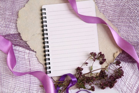 Background for notes with writing pad, ribbons and herbs Stock Photo
