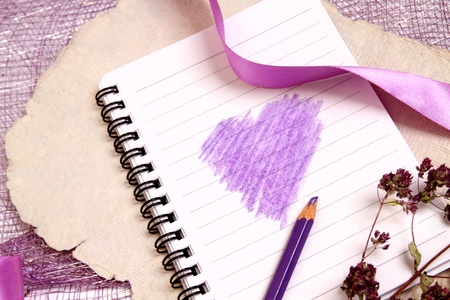Decorative background with writing pad, ribbons and herbs