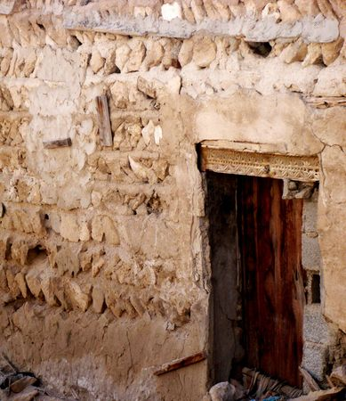 This is an old traditional Arabic home which built of very basic materials and old lantern photo