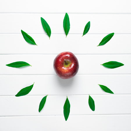 Apple on a wooden background and clock face Stock Photo