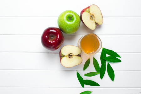 Apples on a wooden background with flowers Stock Photo