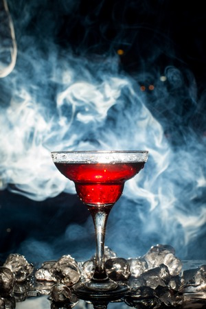 carbondioxide: red cocktail with ice vapor Stock Photo