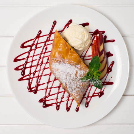 strudel: Apple pie with mint and jam and ice-cream on a plate Stock Photo