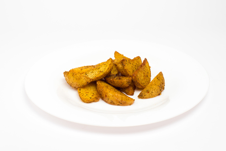 French fries in white plate isolated on white background. Фото со стока
